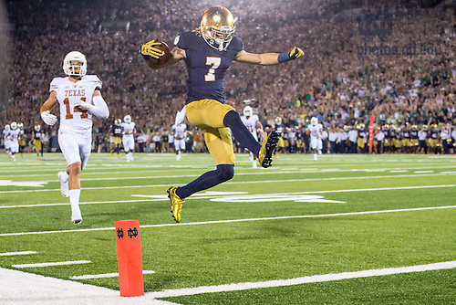 Sept. 5, 2015; Irish wide receiver William Fuller (7) jumps into the end zone for a touchdown. Notre Dame defeated Texas 38-3. (Photo by Matt Cashore)