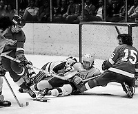 California Golden Seals Ted McAneeley and goalie Marv Edwards battle against the Red Wings,#8 Guy Charron and #15 Bill Hogaboam. (photo/Ron Riesterer)