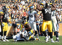 PITTSBURGH - SEPTEMBER 18:  Steve McLendon #90 of the Pittsburgh Steelers celebrates after a sack on Tavaris Jackson #7 of the Seattle Seahawks in the second half during the game on September 18, 2011 at Heinz Field in Pittsburgh, Pennsylvania.  (Photo by Jared Wickerham/Getty Images)