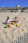 Boys On Beach Playing