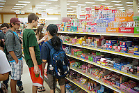 Teenagers in the candy aisle at Mitsuwa asian market during their Obon summer festival in Edgewater, NJ on Saturday. August 18, 2012. The supermarket chain of nine stores located across the country sells Japanese food and goods.  The company holds a yearly summer festival inviting customers to their facilities to enjoy traditional food and partake of the many sales offered on their merchandise. (© Richard B. Levine)