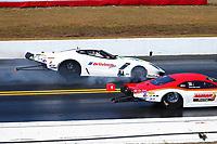 Mar 18, 2017; Gainesville , FL, USA; NHRA pro mod driver Sidnei Frigo (far) alongside Steve Jackson during qualifying for the Gatornationals at Gainesville Raceway. Mandatory Credit: Mark J. Rebilas-USA TODAY Sports