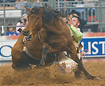 Chris Harris tries to hold on during the bareback riding competition at the Saturday performance of Rodeo Houston at the Houston Livestock Show and Rodeo.