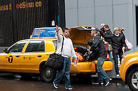 Lower Manhattan residents evacuate after Hurricane Sandy, seen on Tuesday, October 30, 2012. Hurricane Sandy roared into New York disrupting the transit system and causing widespread power outages. Con Edison is estimating it will take four days to get electricity back to Lower Manhattan. (© Richard B. Levine)