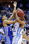 Kentucky Wildcats guard Isaiah Briscoe and North Carolina Tar Heels forward Kennedy Meeks fight for a loose ball during the 2017 NCAA Men's Basketball Tournament South Regional Elite 8 at FedExForum in Memphis, TN on Friday March 24, 2017. Photo by Michael Reaves | Staff