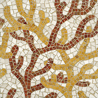 Coral, a hand cut stone mosaic shown in Red Travertine, Persian Gold and Bursa Beige, is part of the Erin Adams Collection for New Ravenna Mosaics.