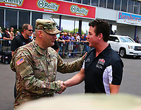 Apr 22, 2017; Baytown, TX, USA; Papa Johns Pizza founder John Schnatter (right) sponsor of NHRA top fuel driver Leah Pritchett (not pictured) greets a US Army soldier on the starting line during qualifying for the Springnationals at Royal Purple Raceway. Mandatory Credit: Mark J. Rebilas-USA TODAY Sports