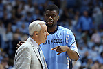 22 December 2012: North Carolina's Reggie Bullock (right) talks to head coach Roy Williams (left). The University of North Carolina Tar Heels played the McNeese State University Cowboys at the Dean E. Smith Center in Chapel Hill, North Carolina in an NCAA Division I Men's college basketball game. UNC won the game 97-63.