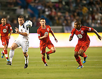 CARSON, CA – June 3, 2011: LA Galaxy forward Chad Barrett (11) and DC United defender Ethan White (15) race to the ball during the match between LA Galaxy and DC United at the Home Depot Center in Carson, California. Final score LA Galaxy 0, DC United 0.