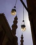 Cairo, Egypt -- Lamps and minarets silhouetted against the clear blue sky at the Sultan Hassan mosque.   © Rick Collier / RickCollier.com.