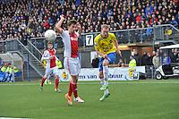 VOETBAL: CAMBUURSTADION: LEEUWARDEN: 15-12-2013, SC Cambuur AJAX, uitslag 1-2, (#12) Michiel Hemmen (CAMBUUR) haalt uit, (#12) Veltman (AJAX) kijkt toe, ©foto Martin de Jong