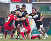 A combination of Justin Melck and Carlos Nieto of Saracens RFC tries to stop Billy Vunipola of London Wasps RFC making progress - London Wasps RFC vs Saracens RFC - Aviva Premiership Rugby at Adams Park, Wycombe Wanderers FC - 12/02/12 - MANDATORY CREDIT: Ray Lawrence/TGSPHOTO - Self billing applies where appropriate - 0845 094 6026 - contact@tgsphoto.co.uk - NO UNPAID USE.