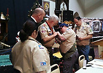 "WATERBURY, CT - Jan. 7 2014 - 010713AL01 - Michael LoVetro, right, pins the Boy Scouts of America Medal of Merit badge on John ""Jack"" Shea, who used the Heimlich maneuver on a man who was choking at a Knights of Columbus picnic last summer. Shea was honored after a Knights of Columbus meeting at the McGivney Center in Waterbury Tuesday night. As a scout leader, Shea taught LoVetro the Heimlich maneuver. Andrew Larson / Republican-American"