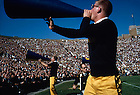 GPHR 26/14:  Football Game Day - Notre Dame vs. Southern California, 1963/1012.  Male cheerleaders yelling through megaphones on the sidelines.<br /> Image from the University of Notre Dame Archives.