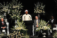 Hamza Abdul Malik recites from the Koran at the start of the memorial service for boxing legend Muhammad Ali at the KFC Yum! Center in Louisville, Kentucky on June 10, 2016.  Ali was involved in the planning of the ceremony which included speeches from leaders of numerous faith as well as comedian Billy Crystal and former American President Bill Clinton.