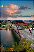 An even storm looms over the Pennybacker Bridge just outside of Austin, Texas. Below are the cool waters flowing out of Lake Travis.