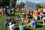 A group of UK FUSION 2011 volunteers waited on Haggin Field before being sent to a site to do community service work for the elderly on Monday, Aug. 22, 2011, in Lexington, Ky. Photo by Becca Clemons | STAFF