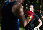 Christopher Malinski and Jacque Graham, of Ohio University's mixed martial arts club, give a demonstration during the Involvement Fair on the College Green on Aug. 24, 2014. Photo by Lauren Pond
