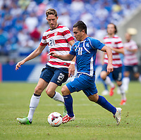 Rodolfo Zelaya, Clarence Goodson.  The United States defeated El Salvador, 5-1, during the quarterfinals of the CONCACAF Gold Cup at M&T Bank Stadium in Baltimore, MD.
