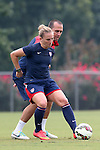 18 August 2014: Amy Rodriguez and assistant coach Damon Nahas (behind). The United States Women's National Team held a training session on Field 4 at WakeMed Soccer Park in Cary, North Carolina.