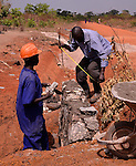 U.S. AID and Winrock's NUDEIL project in Northern Uganda near Gulu.   The $30 million project uses  community labor to build roads, bore holes for water, and schools