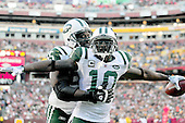 New York Jets wide receiver Santonio Holmes (10) celebrates the go-ahead touchdown in the fourth quarter against the Washington Redskins at FedEx Field in Landover, Maryland on Sunday, December 4, 2011.  The Jets won the game 34 - 19..Credit: Ron Sachs / CNP.(RESTRICTION: NO New York or New Jersey Newspapers or newspapers within a 75 mile radius of New York City)