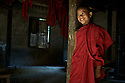 A young monk in Mandalay, Myanmar (Burma) at his monastery.