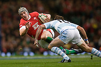 21 Nov 2009 Cardiff Wales ,Jonathan Davies playing for Wales slips as Santiago Fernandez playing for Argentina attempts a tackle  while playing in the Invesco Perpetual International Rugby Union match between Wales and Argentina in the Millennium Stadium. Mandatory credit: Mitchell Gunn ActionPlus