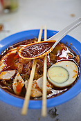 A traditional Hokkien Chinese dish, Curry Mee Hoon is placed for a photo at a hawker stall in capital Georgetown of Penang in Malaysia. Photo: Sanjit Das/Panos