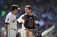 SAN FRANCISCO, CA - OCTOBER 2:  Buster Posey #28 of the San Francisco Giants walks off the field and talks to pitcher Matt Moore #45 during the game against the Los Angeles Dodgers at AT&T Park on Sunday, October 2, 2016 in San Francisco, California. Photo by Brad Mangin