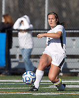 College of St Rose forward Carmelina Puopolo (5) crosses the ball. . In 2012 NCAA Division II Women's Soccer Championship Tournament First Round, College of St Rose (white) defeated Wilmington University (black), 3-0, on Ronald J. Abdow Field at American International College on November 9, 2012.