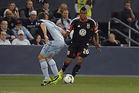 Lionard Pajoy (26) forward D.C Utd faces Matt Besler..Sporting Kansas City defeated D.C Utd 1-0 at Sporting Park, Kansas City, Kansas.