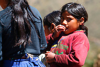 Children beggars eat food given to them along a path in the Lares Valley near Lares, Peru, on May 17, 2008. The Lares Valley contains crystal-clear lakes and unspoiled mountain vistas. The Quechua, indigenous Inca people of Southern Peru with their small villages dotting the region, also populates the network of valleys.
