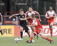 Foxborough, Massachusetts - May 23, 2015: In a Major League Soccer (MLS) match, the New England Revolution (red) tied D.C. United (black), 1-1, at Gillette Stadium.