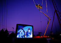 At Iowa's Clay County Fair in Spencer, Iowa, a video camera and microphone capture the mounting tension of Ejection Seat riders while bungee cords attached to two 125-foot towers stretch toward the ground.