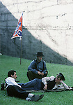 After the the Battle of Fort Morgan, three confederate soldiers rests near the &quot;Star &amp; Bars after a day long battle for  Mobile, Al in 2001. Jim Bryant Photo. @2001. All Rights Reserved.