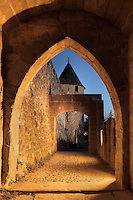 Aude Gate, Citadel of Carcassonne, Aude, France. Carcassonne was a stronghold of Occitan Cathars during the Albigensian Crusades but was captured by Simon de Montfort in 1209. He added extra fortifications and Carcassonne became a citadel on the French border with Aragon. The fortress restored in 1853 by Eugene Viollet-le-Duc. Today it is a UNESCO World Heritage site. Picture by Manuel Cohen