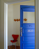The traditional front door has been painted a bright cobalt blue