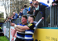David Wilson and Jeff Williams of Bath Rugby pose for a selfie with a supporter after the match. Aviva Premiership match, between Bath Rugby and Sale Sharks on April 23, 2016 at the Recreation Ground in Bath, England. Photo by: Patrick Khachfe / Onside Images