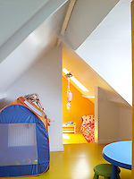 The children's bedrooms are situated under the eaves of the old worker's cottage