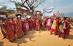 Women gather to celebrate International Women's Day on March 8, 2016, in Dhawa, a village in the Gorkha District of Nepal.<br /> <br /> The banner reads, &quot;106th International Women's Day&quot; and &quot;Implement the Constitution and Guarantee Women's Rights.&quot;
