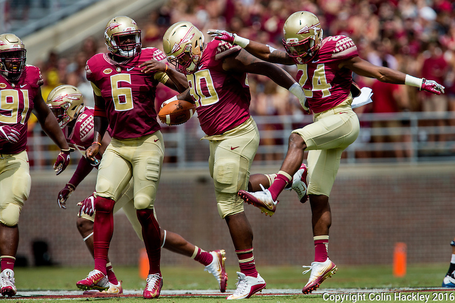 TALLAHASSEE, FLA 9/10/16-Florida State's Demarcus Christmas, center, celebrates recovering a Charleston Southern fumble with Derrick Nnadi, left, Matthew Thomas and Marcus Lewis during first quarter action Saturday at Doak Campbell Stadium in Tallahassee. <br /> COLIN HACKLEY PHOTO