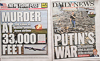 New York tabloid newspapers on Friday, July 18, 2014 report on the previous days alleged missile strike on Malaysian Flight 17 over the Ukraine. (© Richard B. Levine)