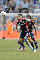 Benny Fellhaber (22) midfield New England Revolution in action..Sporting Kansas City and New England Revolution played to a 0-0 tie at LIVESTRONG Sporting Park, Kansas City, KS.