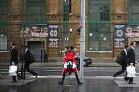 Duke Street Hill buildings and pedestrians reflected in a glass building, Bankside, Southwark, London, UK.