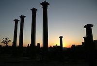 Sunset silhouette of 4 Corinthian columns, each 14m high, 1,20m circumference, Nymphaeum Temple, 2nd century AD, Bosra, Syria. Ionic columns in background Picture by Manuel Cohen
