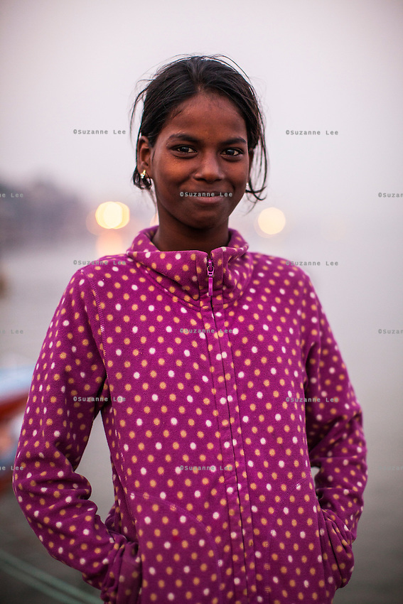 Moni, 10, poses for a portrait on the Boat School Guria runs on the holy Ganges River, in Varanasi, Uttar Pradesh, India on 19 November 2013. The school, accommodating almost 50 children, aims to take the boatmen's children away from working in the tourist areas where they are exposed to trafficking and sexual abuse.