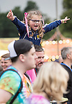 Electric Fields music festival at Drumlanrig Castle near Dumfries Scotland. In the crowd girl, with Scotland football top, on mans shoulders enjoying the music,