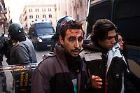 Roma 14 Dicembre 2010.<br /> Manifestazione contro il Governo Berlusconi.  Un manifestante ferito durante gli scontri e fermato dalla polizia in Via del Corso.<br /> Rome December 14, 2010.<br /> Demonstration against the Berlusconi government.