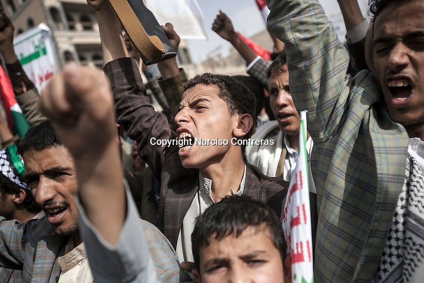 """Friday 10 July, 2015: Houthi militants demonstrate in solidarity with the Palestinian people during the commemoration of """"Al Quds"""" as well as against the Saudi-led war of intervention in their country in the capital city of Sana'a. (Photo/Narciso Contreras)"""